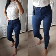 Kõrge pihaga sinised teksad